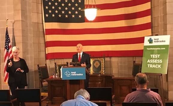Gov. Ricketts (podium) gives remarks at this morning's press conference.