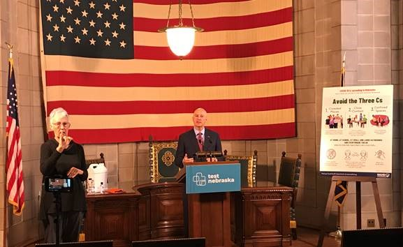 Gov. Ricketts (podium) discusses the State of Nebraska's coronavirus vaccine distribution plan.