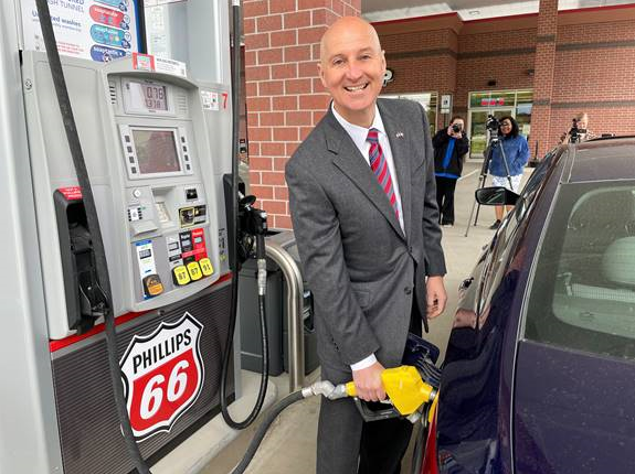 Gov. Ricketts pumps ethanol-blended gas at U-Stop in Lincoln to promote the use of renewable fuels.