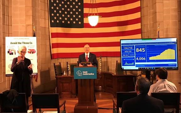 Gov. Ricketts (podium) announces new statewide Directed Health Measures  to reduce the required duration of quarantines while speaking at today's press briefing.