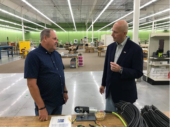 Governor Ricketts learns from Production Manager Gerald Cline about the manufacturing process at Subconn in the Ord.