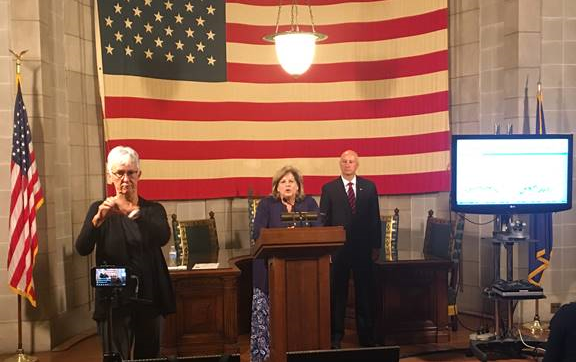 DHHS Director of Behavioral Health Sheri Dawson and Gov. Ricketts at this morning's press conference.