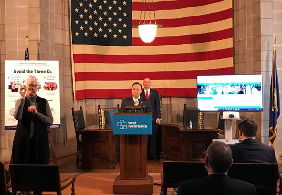 Nebraska Tax Commissioner Tony Fulton (podium) and  Gov. Ricketts (in back of podium) at this morning's press conference.