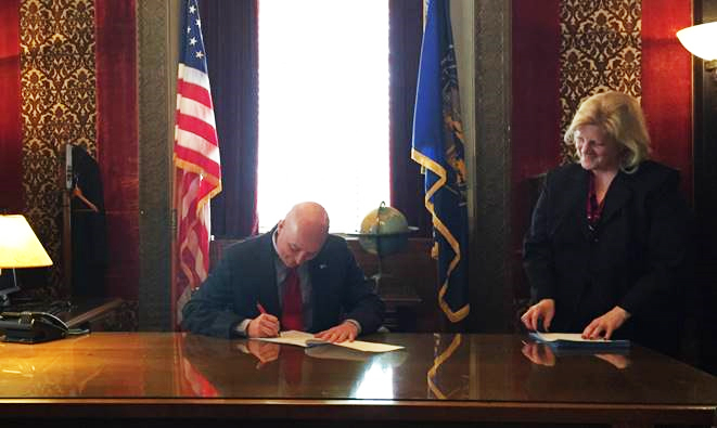 Governor Pete Ricketts signing legislation into law for the first time
